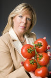 Woman with bunch of fresh ripe tomatoes Stock Image