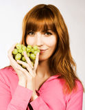 Woman with bunch of grape Stock Images