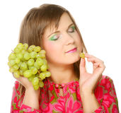 Woman with bunch of grape. Royalty Free Stock Photos