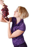 Woman with bunch of grapes Stock Image