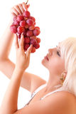 woman with bunch of grapes Stock Images