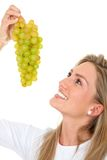 Woman with a bunch of grapes Stock Photos