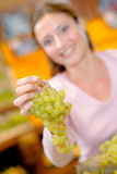 Woman with bunch grapes Royalty Free Stock Image