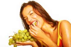 Woman with bunch of grapes Stock Photo