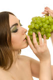 Woman with bunch of green grapes Stock Image