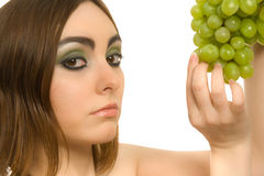 Woman with bunch of green grapes Royalty Free Stock Image