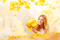 Woman with bunch of maple leaves royalty free stock images