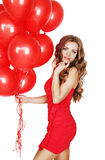Woman with a bunch of red balloons Royalty Free Stock Images