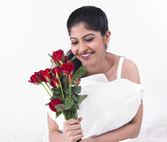 Woman with a bunch of red roses Stock Image