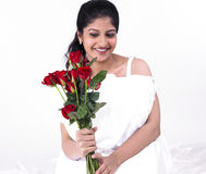 Woman with a bunch of red roses Royalty Free Stock Photography