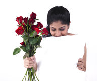 Woman with a bunch of red roses Royalty Free Stock Photos