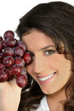 Woman with bunch of ripe grapes Royalty Free Stock Photography