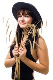 Woman with bunch of wheat in blue hat smile Stock Photos