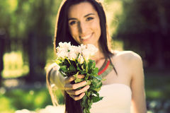 Woman with bunch of white flowers  Royalty Free Stock Image