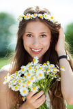 Woman with bunch of wildflowers Royalty Free Stock Images