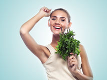 Woman with a bundle of fresh mint. Concept vegetarian dieting - Stock Image