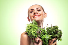 Woman with a bundle of fresh mint. Concept vegetarian dieting - Stock Photos