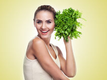 Woman with bundle herbs (salad) Stock Image