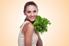 Woman with bundle herbs (salad). Concept vegetarian dieting - he Stock Images