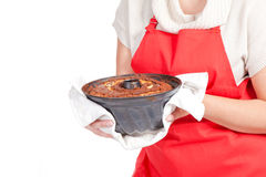Woman with bundt cake and red apron Stock Photos