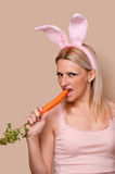 Woman with bunny ears and carrot Stock Photography