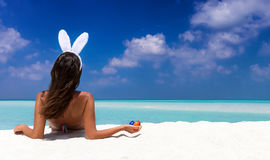 Woman with bunny ears and colorful easter eggs Stock Photography