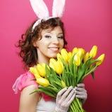 Woman with Bunny Ears holding yellow tulips Stock Image