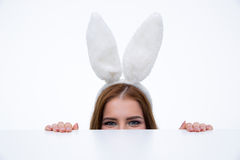 Woman with bunny ears looking over table Royalty Free Stock Photos