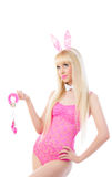 Woman in bunny ears looking up at copyspace Stock Photo