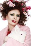 Woman with a bunny, eggs and flowers spring easter concept Stock Photos