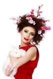 Woman with a bunny, eggs and flowers spring easter concept Royalty Free Stock Photo