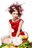 Woman with a bunny, eggs and flowers spring easter concept Royalty Free Stock Image