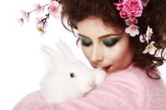 Woman with a bunny, eggs and flowers spring easter concept Royalty Free Stock Photos