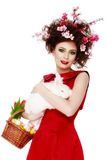 Woman with a bunny, eggs and flowers spring easter concept Royalty Free Stock Photography