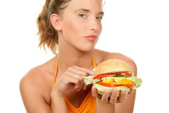 Woman with burger Royalty Free Stock Photo