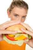 Woman with burger Stock Image