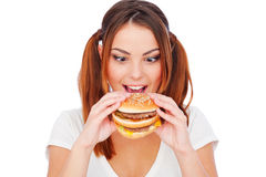 Woman with burger Royalty Free Stock Image