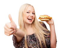 Woman with a burger Stock Image