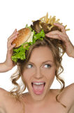 Woman with burger and fries shouts Stock Image