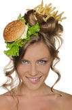 Woman with burger and fries smiling Stock Photos