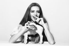 Woman with burger and pigglet Royalty Free Stock Photos