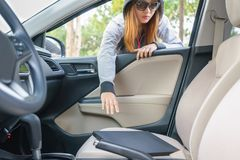 Woman burglar steal a laptop through the window of car - theft c. Oncept stock photos