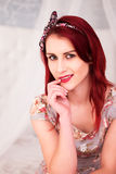 Woman with Burgundy Hair Looking at Camera Royalty Free Stock Photography