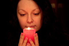 The woman with burning candle Royalty Free Stock Photos