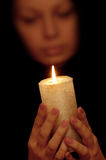 The woman with burning candle Stock Images