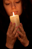 The woman with burning candle Stock Photography