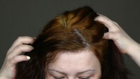 Woman burnt hair.On the face of the emotion of horror.Red hair like straw dry.