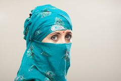 Woman in burqa with makeup. Mature woman in Burqa on gray background with closed eyes and beautiful makeup Stock Photos