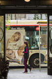 Woman and a bus Stock Photo