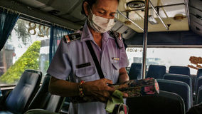 Woman bus conductor royalty free stock photography